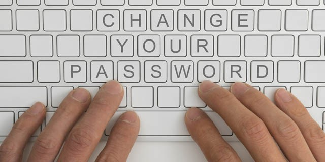hands on a keyboard - change password